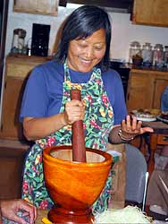 Kasma uses a wooden mortar & pestle